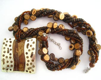 SALE Vintage Tribal Pendant Necklace. Modern Silver Cut Out & Wood Look Pendant. 5 Strands, 3 of Wood, 2 of Glass Beads, and a Few Silvers
