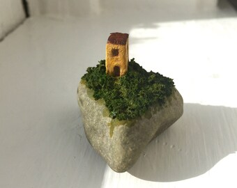 A House Built on Rock - tiny yellow clay building in a tangle of growth