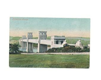 very old color postcard of the Britannia Bridge, Wales, postally unused