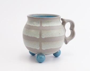 "Stoneware tripod mug. Aqua blue and grey ""ball footed"" striped coffee mug. Wheel thrown pottery mug. ceramics. Tea cup"