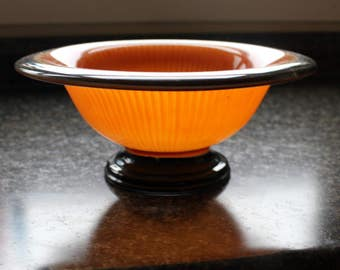 Vintage orange and black glass bowl. 10 inch diameter. ribbed bowl black rim and pedestal foot. fantastic art deco style perfect condition
