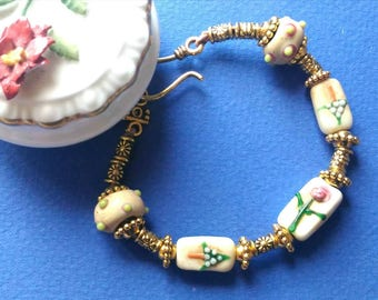 DAINTY and IRRESISTIBLE  flower decorated glass beads and golden spacers