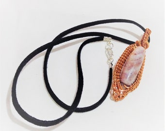 a simple jasper gemstone wire wrapped pendant on a black corded necklacw