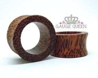 """Coconut Wood Tunnels. 4g / 5mm, 2g / 6.5mm, 0g / 8mm, 00g / 10mm, 1/2"""" / 12.5mm, 9/16"""" / 14mm, 5/8"""" / 16mm, 11/16"""" / 18mm, 3/4"""" / 19mm"""