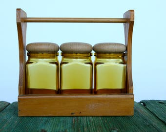 Retro yellow glass jars in wooden holder