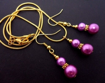 A hand made gold tone purple glass pearl  necklace and  earring set.