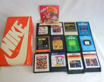 12 Vintage Atari Games w/vintage NIKE Shoe Box & 1983 Dentist Activision Advertisemnet offers considered