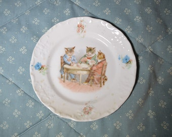 A Vintage Plate Showing Three Cats Playing Cards