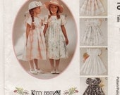 An Empire Waist, Tulip Sleeve, Full Skirt, Back Button / Tie Sash Dress Pattern for Children: Uncut - Sizes 4-5-6 ~ McCall's 8116