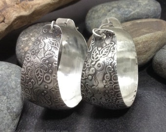 Sterling silver hoop earrings, flowing abstract vine & leaf foliage pattern with gray patina, medium sized, convex shape lightweight