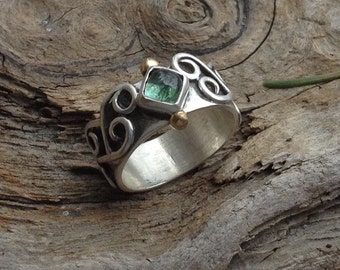 Green tourmaline ring with flowing swirls overlaid on solid band, square stone, brass balls, sterling silver metalwork fits size 7