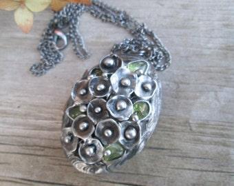 metal pendant medallion Photo  with peridot