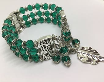 Three Tiered wrap bracelet made with Emerald Green Swarovski Crystal.