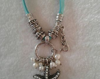 Beachy Bohemian necklace with Starfish, Mermaid, and freshwater Pearls.
