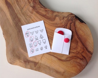 """Care instructions and small extras envelope - 5 care cards and 1 """"extras"""" envelopes"""