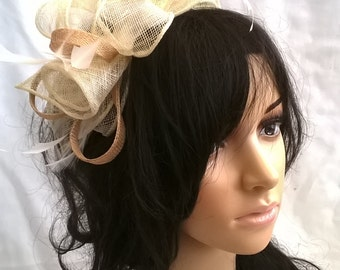 Beautiful Creamy Ivory with pale gold Sinamay and  Feather rosette Fascinator on a headband
