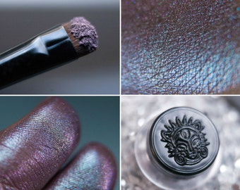 Eyeshadow: Spellbound Virgin of the Castle- Undead. Gray-pink-purple smoke eyeshadow by SIGIL inspired.