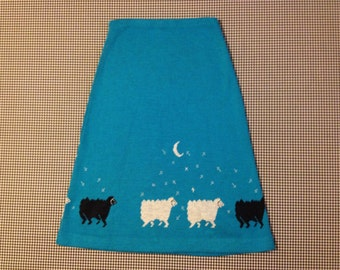 1980's,A-line, sweater skirt, in turquoise, with sheep, moon and stars, Women's size Small/Medium