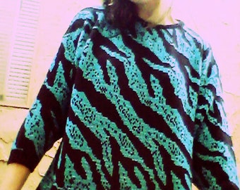 RAD Retro zebra print Bright blue and black knit sweater with hints of silver to look sparkly! size med-lrg length 28