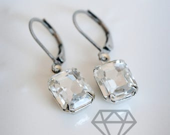 Dainty Clear Rhinestone Leverback earrings in an antique silver setting