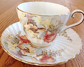 Aynsley swirl English bone china tea cup and saucer covered in orchids