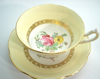 Collingwoods Tea Cup and Saucer, Yellow and Gold teacup with pink and yellow flowers.
