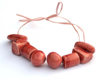 Handmade Ceramic Beads in Various Shapes in Deep Red