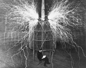 Nikola Tesla, Reading with electricity overhead, photograph, photo, 1890's