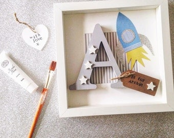 Personalised boys frame- a customised Rocket frame with a wooden letter, stars and a name on a hand stamped tag. A unique gift