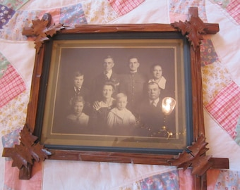 Carved Black Forest Picture Frame with Picture From Early 1900's
