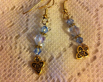 Light blue and gold plated pierced earrings with Celtic knot charms.