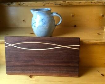 Walnut cutting board w/ maple ribbon