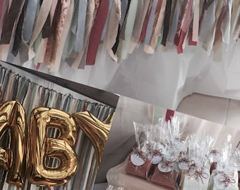 Streamer backdrop with matching table bunting