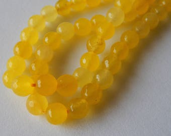 8mm Faceted Yellow Jade Rounds
