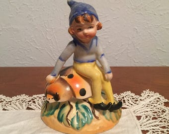 POODLE CIRCUS / / Occupied Japan Figurine of small pixie elf seated joyfully on a large lady bug - in good condition.