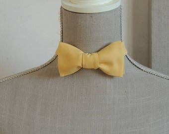 Bow tie, yellow wheat color.