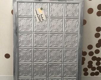 Vintage tin tile message board