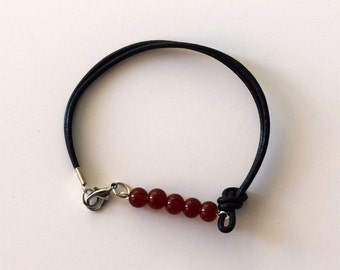 Leather and red bead bracelet