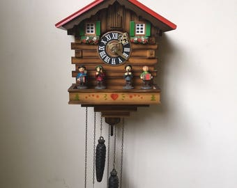 Cuckoo Clock made by Kuner  A RARE  Vintage clock made in Germany   Mint to excellent condition with original metal weights and chains~
