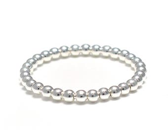 Narrow ring of silver beads from 925 sterling silver
