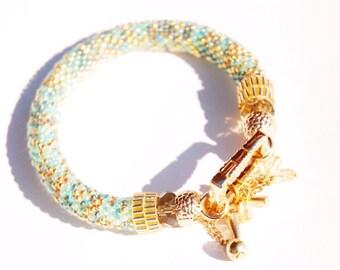 Beadwoven mint bracelet with pendant