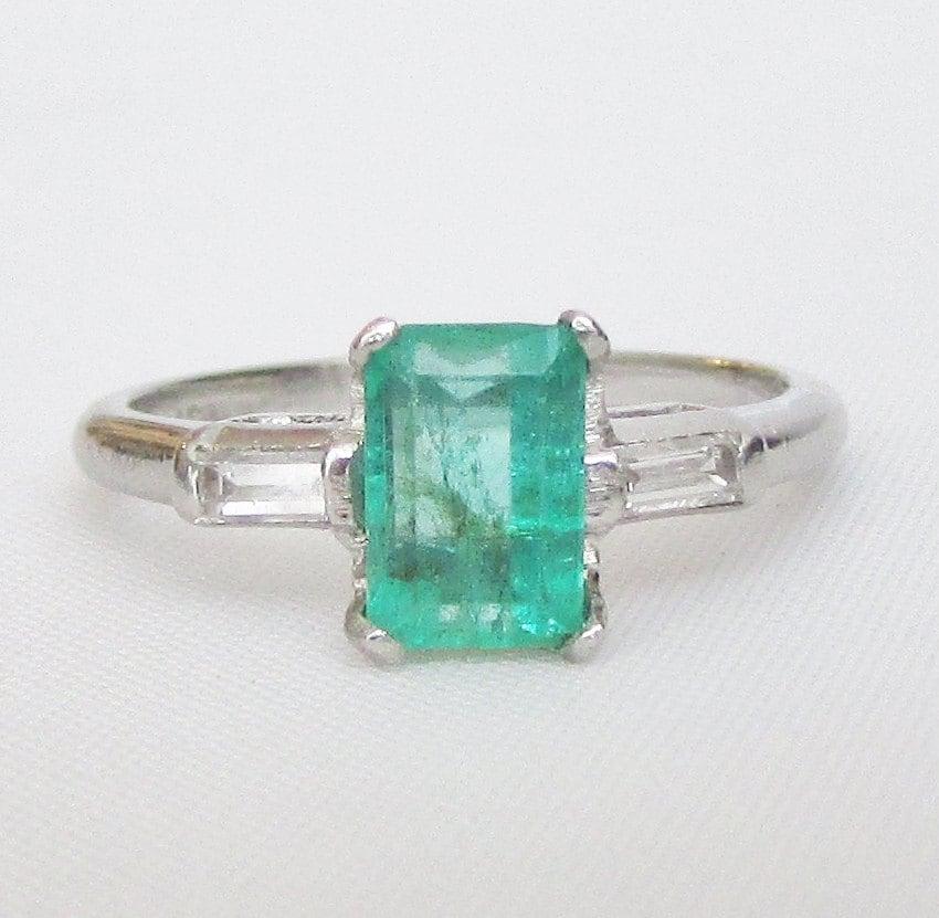 platinum emerald and baguette ring graduate