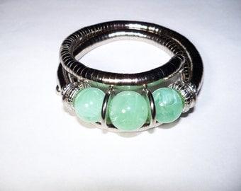 A Charm Bangle Bracelet. (201762)
