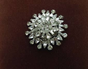 Vintage Starburst Pin.....Multifaceted shaped stones....full of shine and glam...great condition