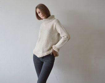 vintage beige turtle neck sweater with fringed triangle hem and fringed cuffs