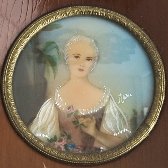 Miniature painting of Louise Henriette de Bourbon, square wooden frame with decorative gold metal circle around the painting, signed