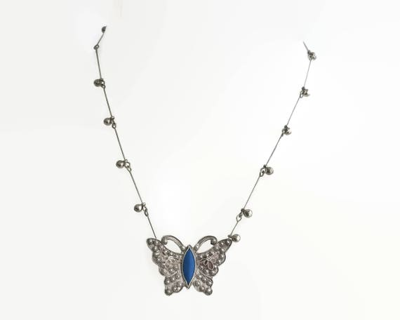 Solid silver handmade butterfly pendant with blue enamel body and filigree overlay, silver metal chain with Edwardian links and tiny balls