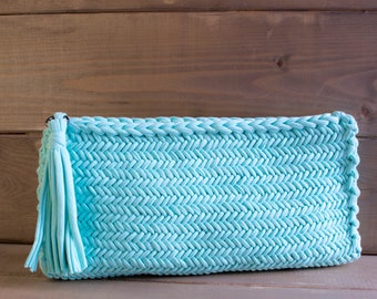 Ready! Turquoise clutch with tassel.