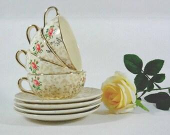 Villeroy & Boch Porcelain set for 4 ivory golden cups wit red flowers Villeroy and Boch Saar 1940.