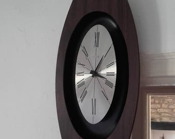 Vintage 60's Mid Century Modern Minimalist Elgin Wall clock with a faux wood-grain
